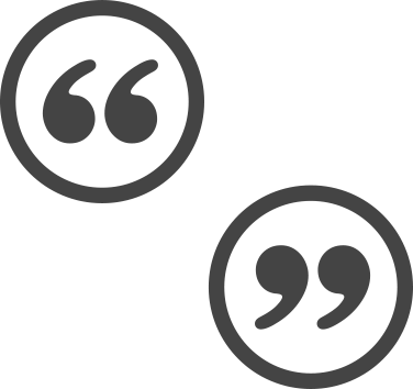 Grey quotation marks in grey circles positioned diagonally from each other.